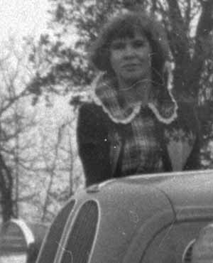 Unknown woman by Car
